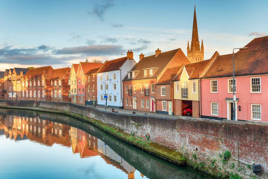 Colourful houses and Norwich Cathedral along the River Wensum